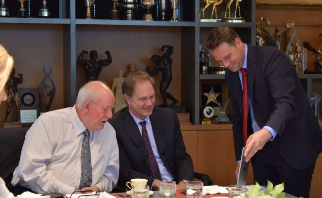 Governor Schwarzenegger video conferences with Charles Clarke and Dean Jack Knott.